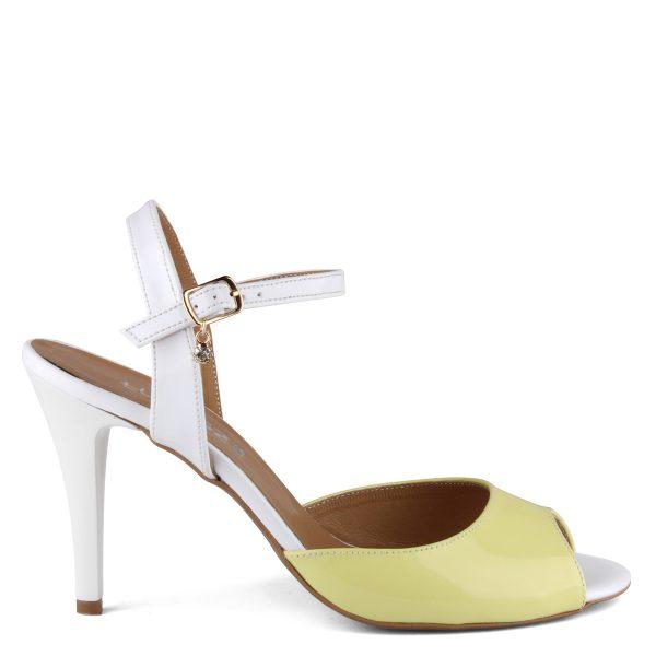 Magas sarkú Lukasz női szandál sárga-fehér színkombinációban. Sarka kb 9 cm magas, felsőrésze lakk bőr, bélése természetes bőr. - ChiX Női Cipő Webáruház