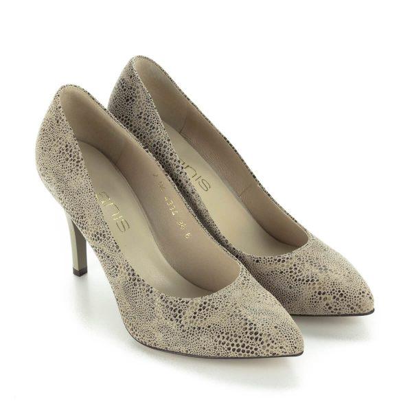 Magas sarkú bőr női cipő pöttyös mintás felsőrésszel. Sarka 9 cm magas. A cipő bélése és felsőrésze is bőrből készült, elegáns alkalmi cipő.