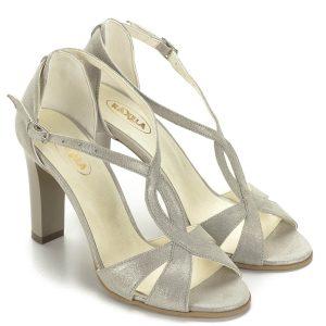 Arany magassarkú Raxela női szandál 9 cm magas sarokkal. Anyaga kívül belül bőr, pántjai jól tartják a lábat. Csinos női alkalmi szandál.